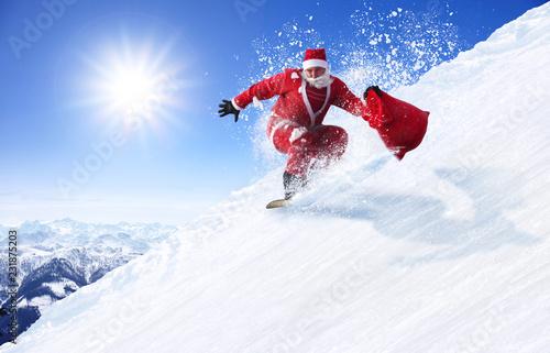 Leinwanddruck Bild Weihnachtsmann auf dem Snowboard