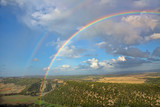Double rainbow over a valley in Andalusia, Spain near the town of Vejer de la Frontera with breathtaking views over the countryside. - 231875464