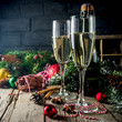 Leinwanddruck Bild - Two glasses of champagne with Christmas decoration on wooden background, Happy New Year and Xmas Celebration. Copy space