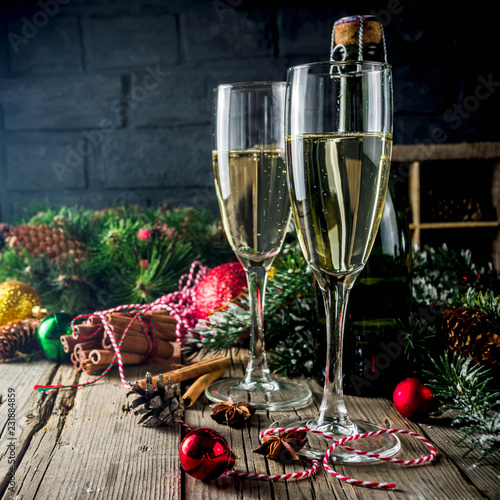 Leinwanddruck Bild Two glasses of champagne with Christmas decoration on wooden background, Happy New Year and Xmas Celebration. Copy space