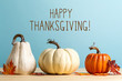 Thanksgiving message with pumpkins on a blue background