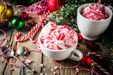 Christmas dessert, Homemade Peppermint Candy Cane Ice Cream in two cups, old wooden background with xmas decorations copy space - 231886004