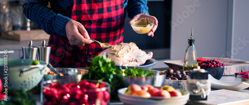 Wall mural Man preparing delicious and healthy food in the home kitchen for christmas (Christmas Duck or Goose)