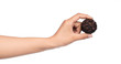 hand holding chocolate ball isolated on a white background