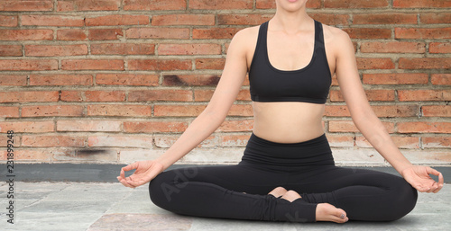Poster Close-up of of young woman meditating in yoga poses