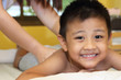 Little boy getting a massage