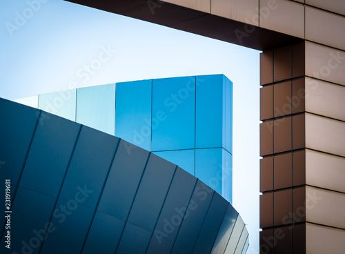 fragment of an office building with blue and yellow panels - 231919681