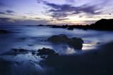 Rocky seascape at dusk - 231922486