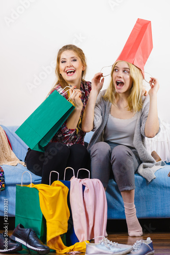 Two happy female friends after shopping © Voyagerix