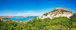 Panoramic view of Acropolis of Lindos, traditional houses and lemon trees (Rhodes, Greece)