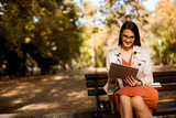Young woman using digital tablet in the park - 231923899