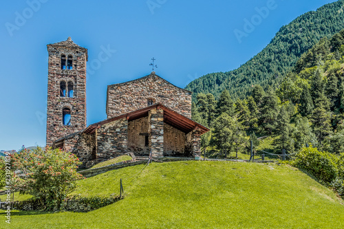 Leinwanddruck Bild Hilltop and stone church facade in the Pyrenees. Andorra Europe