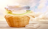 Laundry Basket with colorful towels on background - 231934001