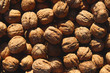 A lot of ripe walnuts dry in the sun. Autumn harvest. Natural and healthy food. Beautiful natural texture. Photo background.