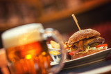 american hamburger with glass of beer of wine in american restaurant, product photography for restaurant in american style - 231938019