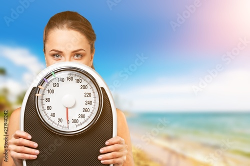 Leinwanddruck Bild Holding young hold woman scales white background one person