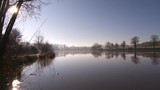 Absolutely stunning wide shot of a glassy lake early in the morning - 231943004