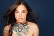 beautiful woman wearing big glamorous necklace