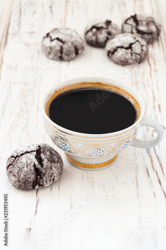 Poster A small cup of black coffee and chocolate brownies on a white wooden background.