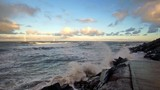 The North Sea in Northumberland on a windy afternoon with beautiful clouds above and waves crashing against the rocks. Half Speed, Slow Motion - 231967238