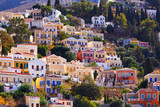 Multi-colored houses on the shore of the ancient harbor on the island of Symi. Coast of the Aegean. Greece - 231970221