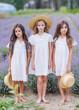 portrait of three girls girlfriends in nature