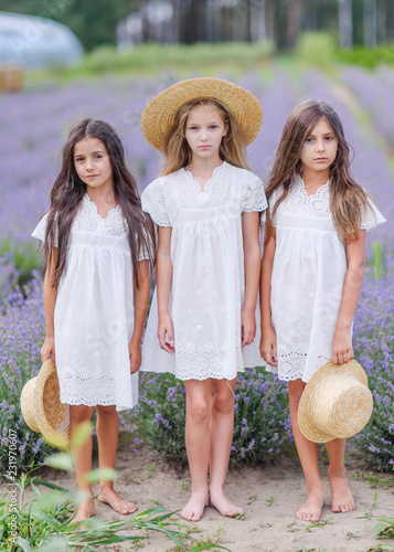 Foto Murales portrait of three girls girlfriends in nature