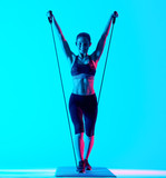 one mixed races woman exercsing fitness elastics  exercices isolated on blue blackground - 231994616