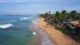 Flight over the tropical beach in the town of Hikkaduwa, Sri Lanka - 231996463
