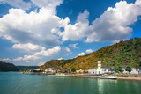 View along the beautiful Rhine River in Germany with the Village of Sankt Goar in view - 231998643