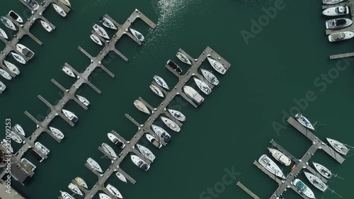 Top down aerial view travelling along the length of a yacht pier on Montrose harbor on lake Michigan, Chicago