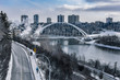Walterdale Bridge spanning over the North Saskatchewan River in Edmonton, Alberta, Canada. Taken during a cold and cloudy winter day on November 5, 2018.