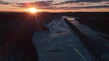 Absolutely stunning cinematic aerial shot of a frozen river at sunset - 232028818