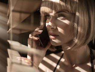 Closeup portrait of a calm woman talking on the phone © konradbak