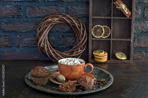 Poster Hot chocolate with marshmallows and muffins on the table - background about dessert