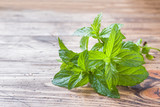 Green fresh mint on wooden table, selective focus - 232033629