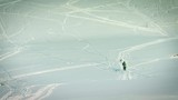 Long lens shot of three people and their dog hiking through the snow - 232035259