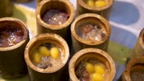 A close up of a traditional asian dish, sticky rice in bamboo - 232042037