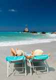 Couple on sunbeds relaxing at the beach in Lefkada