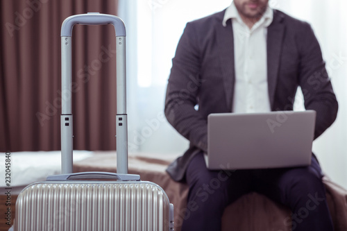 Foto Murales Bearded businessman coming to hotel room while on business trip