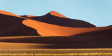 Panoramic view of a Sossusvlei big orange sand dune against blue sky, Namibia - 232047259