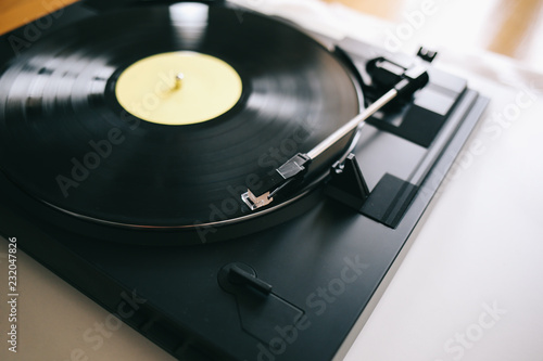 Turntable with gramophone record playing music