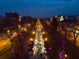 overhead view of european city in night time. people walk by fair in evening - 232053290