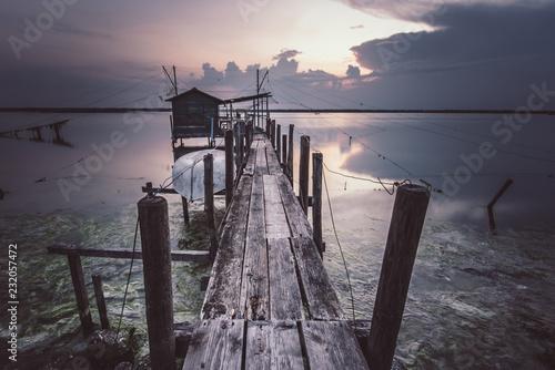 Acrylglas Pier tramonto con casetta del pescatore