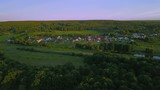 Russian suburban village with cottage houses on background summer sunset - 232060081