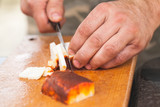 Smoked lard slicing. Cook hands with knife - 232061887