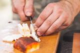 Smoked lard slicing on wooden board - 232061897
