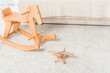 wooden horse and retro airplane toys on bedroom floor