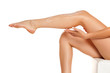 Leinwanddruck Bild - woman applying lotion on her legs on white background