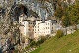 Predjama Castle in Slovenia. - 232077021